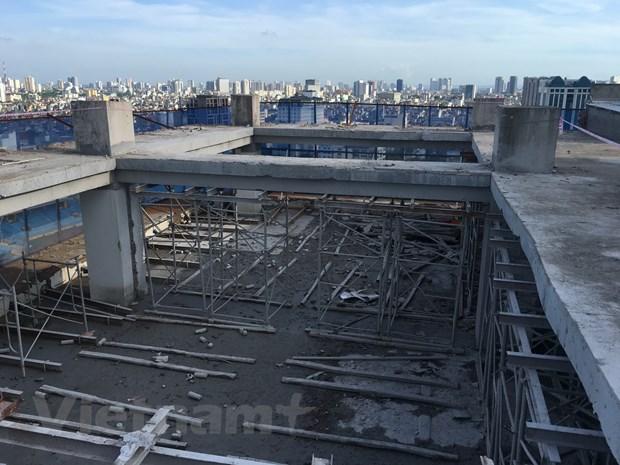 Hoàn thành phá dỡ tầng 18 tòa nhà 8B Lê Trực - Hà Nội - Ảnh 1.