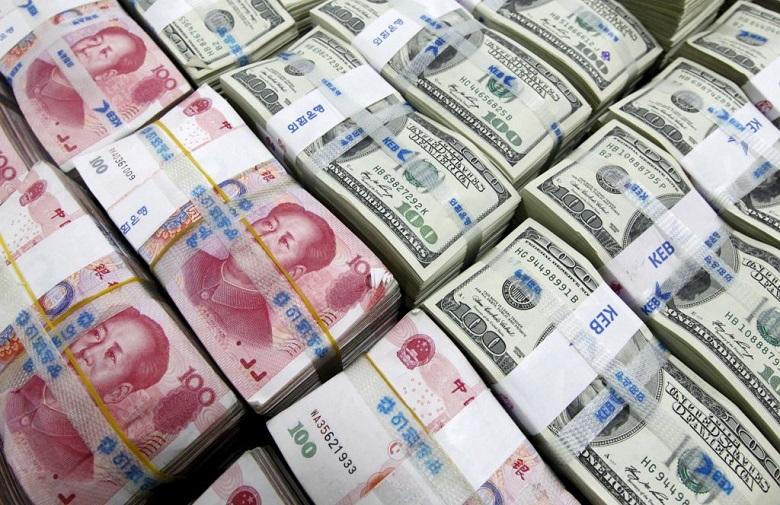 Giới phân tích: Đồng NDT sẽ tiếp tục tăng giá so với USD - Ảnh 1.