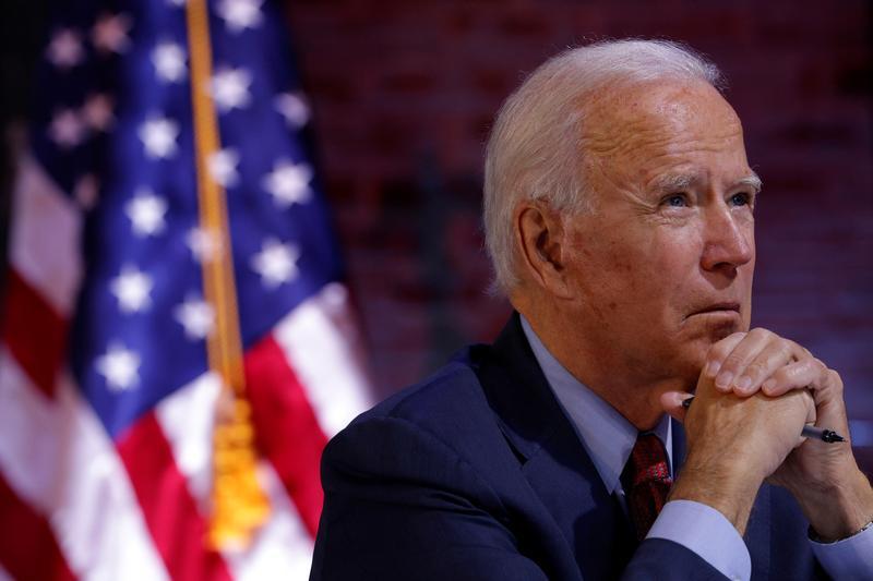 Ông Biden bỏ phiếu sớm cùng 74 triệu cử tri Mỹ - Ảnh 1.