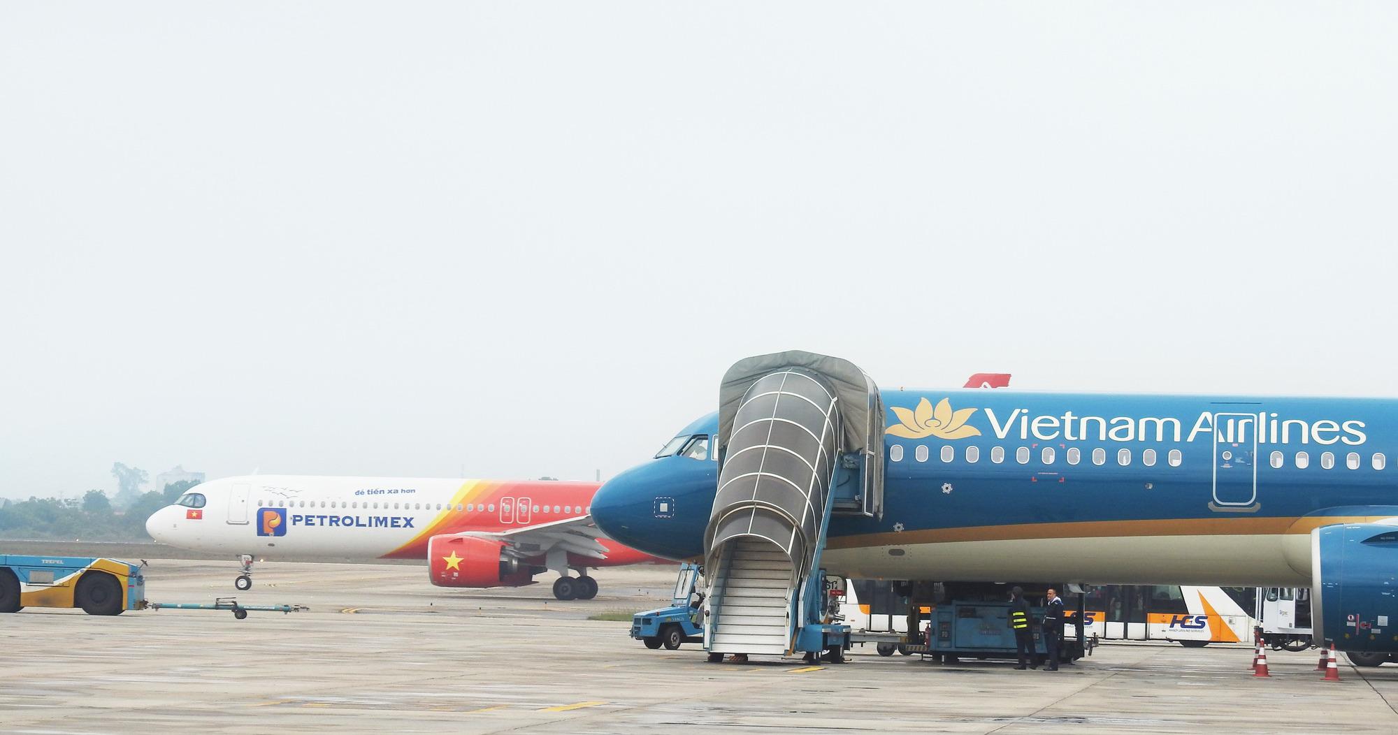 Chính sách hoàn vé, đổi lịch bay của các hãng hàng không Việt trong đợt dịch COVID-19 - Ảnh 1.