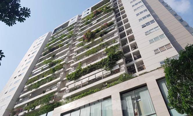 Cận cảnh khu đất công làm bãi xe 'biến hình' thành cao ốc ở Hà Nội - Ảnh 5.