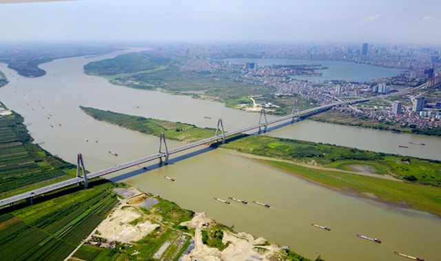 Ông Vương Đình Huệ: Qui hoạch phân khu sông Hồng vẫn 'dậm chân tại chỗ' do vướng mắc pháp lệnh đê điều  - Ảnh 1.