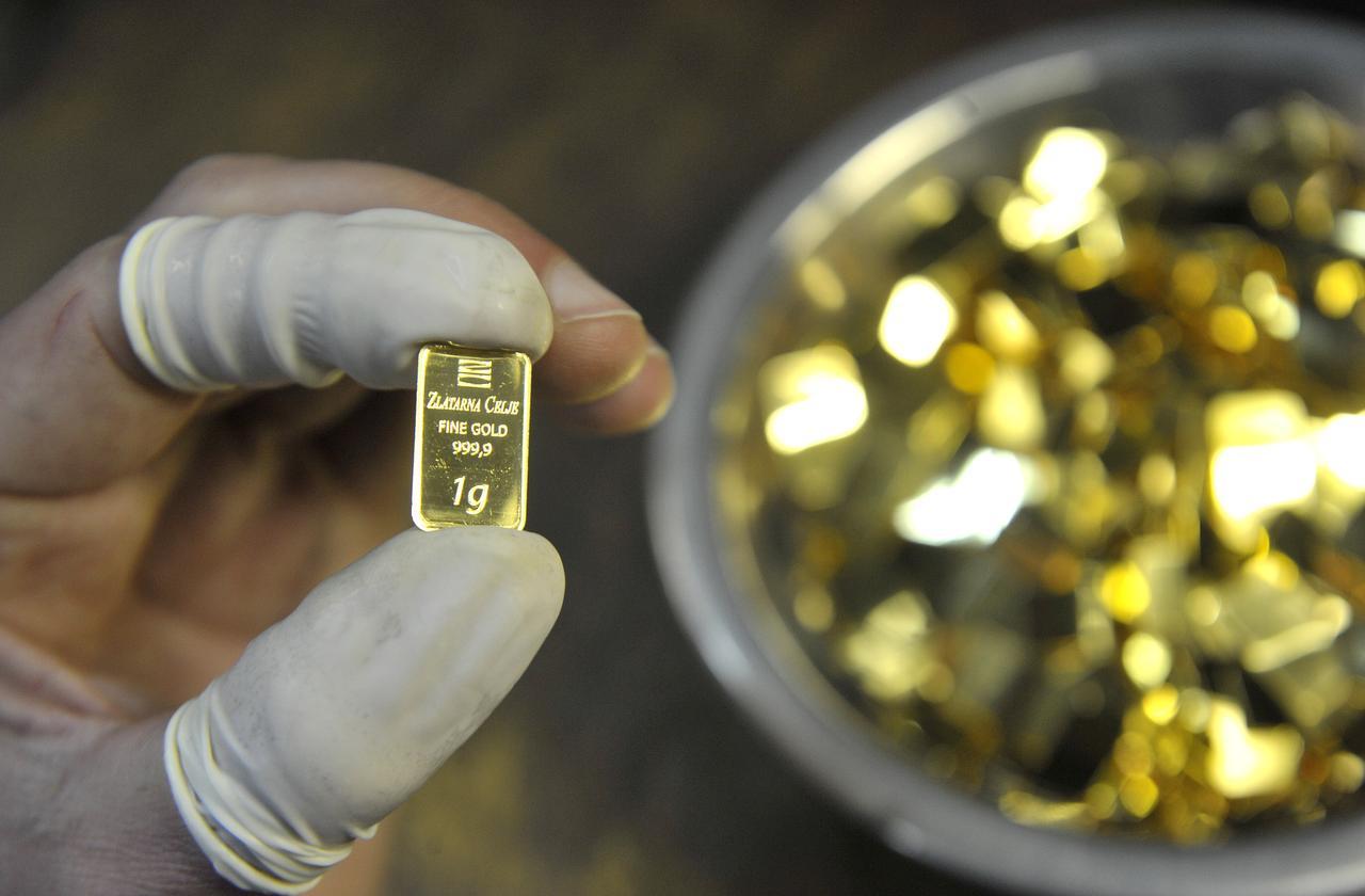 Giá vàng hôm nay 9/5: Thị trường thế giới tăng hơn 1% trong tuần này - Ảnh 1.