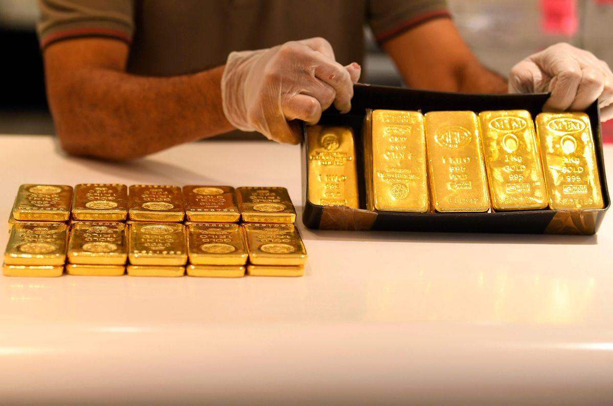 Cơn sốt vàng toàn cầu: Phố Wall ném tiền tỉ vào các công ty khai thác kim loại quí - Ảnh 2.