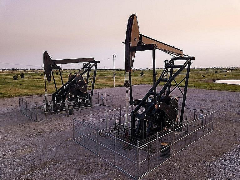 Giá xăng dầu hôm nay 22/8: Dầu tiếp tục giảm do nhu cầu tiêu thụ còn quá thấp - Ảnh 1.