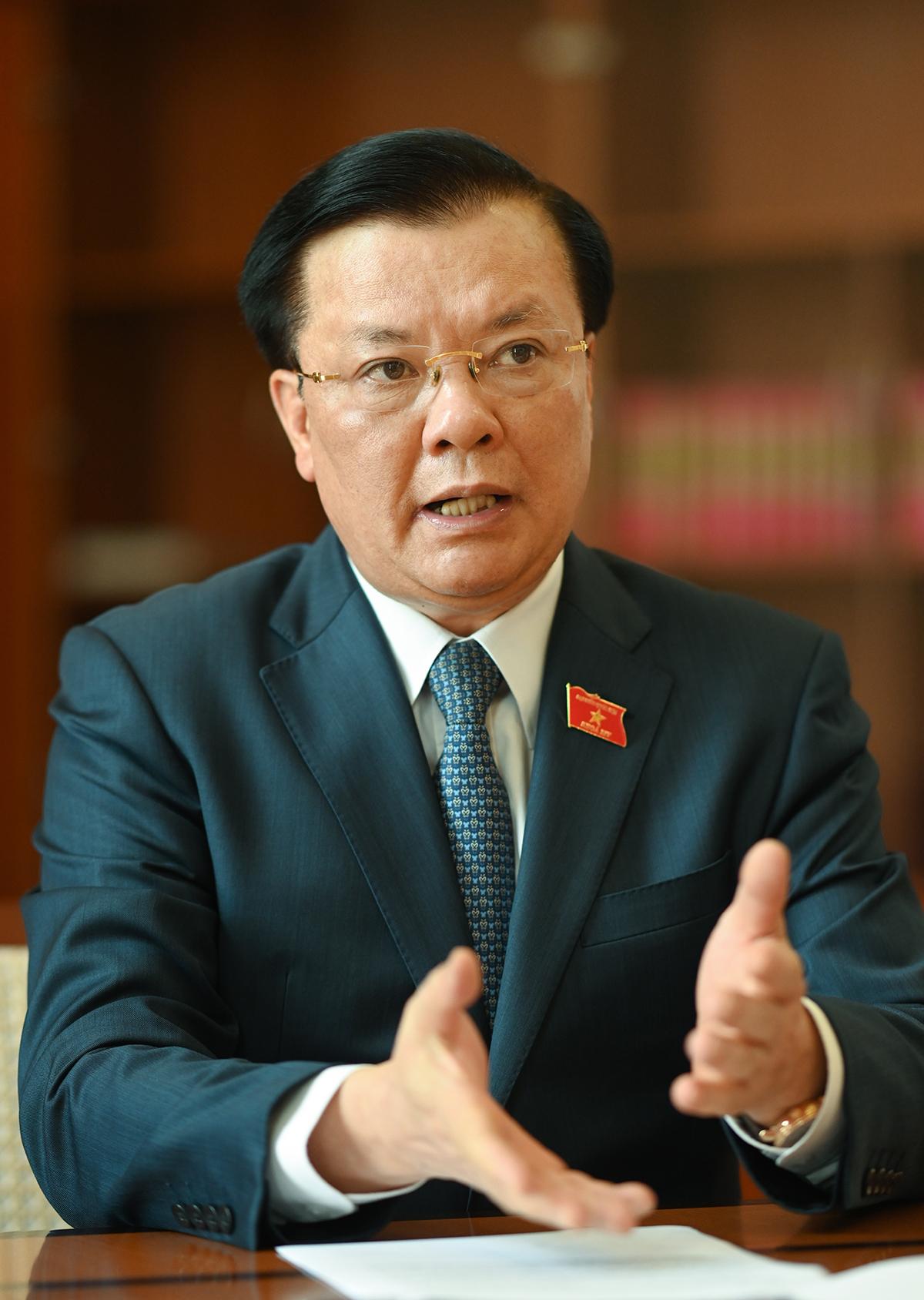 [eMagazine] Bộ trưởng Đinh Tiến Dũng: Không vì mục tiêu nâng hạng mà đánh đổi an toàn hệ thống tài chính quốc gia - Ảnh 2.