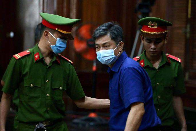 Ông Nguyễn Thành Tài hầu tòa trong vụ khu đất vàng Lê Duẩn TP HCM - Ảnh 1.
