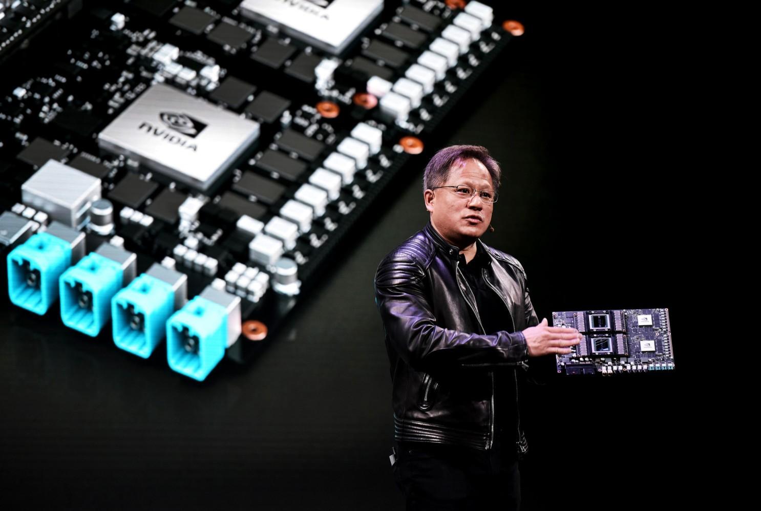 Vụ thâu tóm chấn động ngành công nghệ toàn cầu có thể gặp lực cản từ Trung Quốc - Ảnh 1.