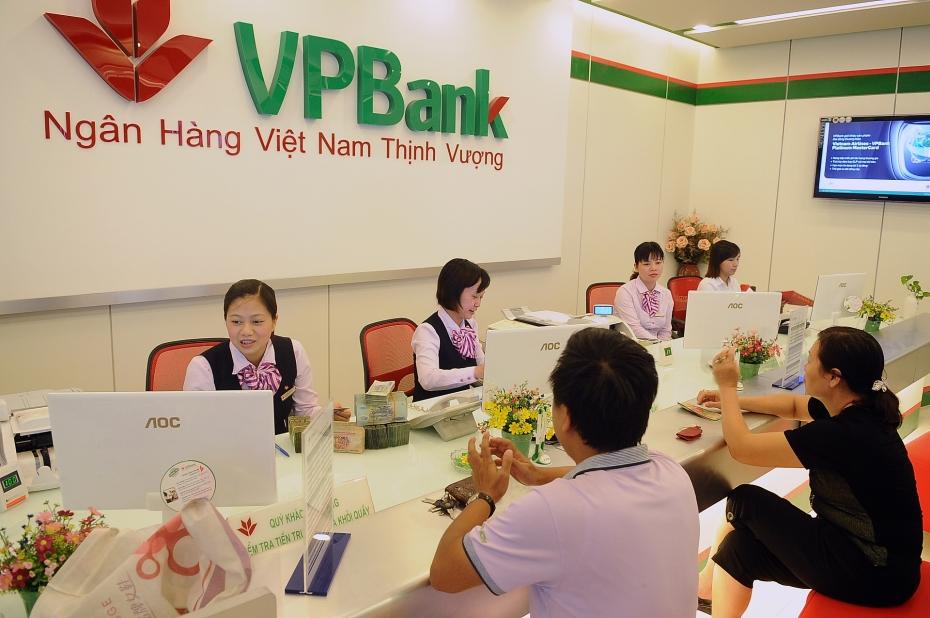 Ngân hàng tăng cường hỗ trợ doanh nghiệp SME - Ảnh 1.
