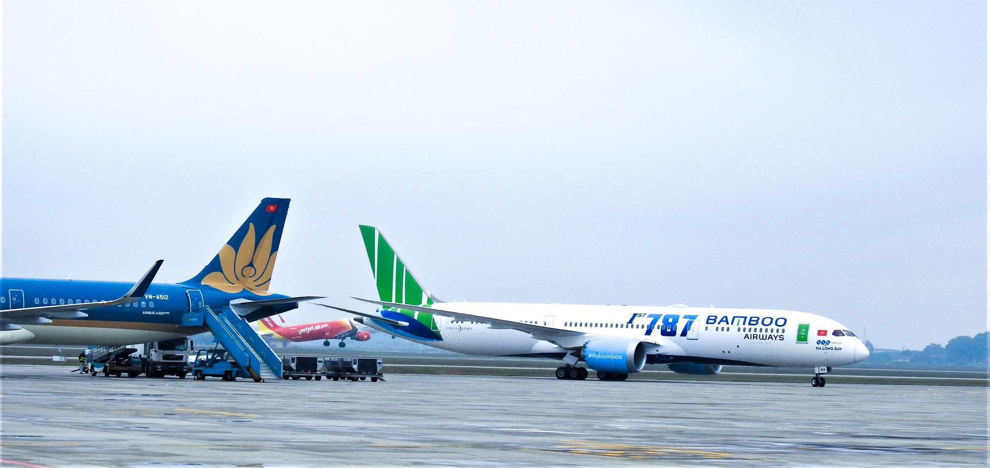 Mở lại đường bay nước ngoài: Tìm điểm cân bằng giữa kinh tế và y tế - Ảnh 1.