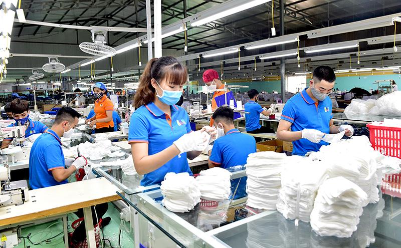 Đâu là yếu tố rủi ro nhất cho tăng trưởng kinh tế Việt Nam năm 2021? - Ảnh 1.