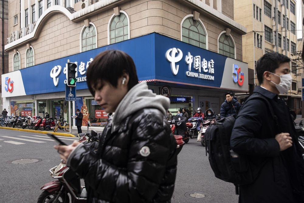 Sàn chứng khoán New York một lần nữa đổi ý, hủy niêm yết ba công ty Trung Quốc lớn - Ảnh 1.