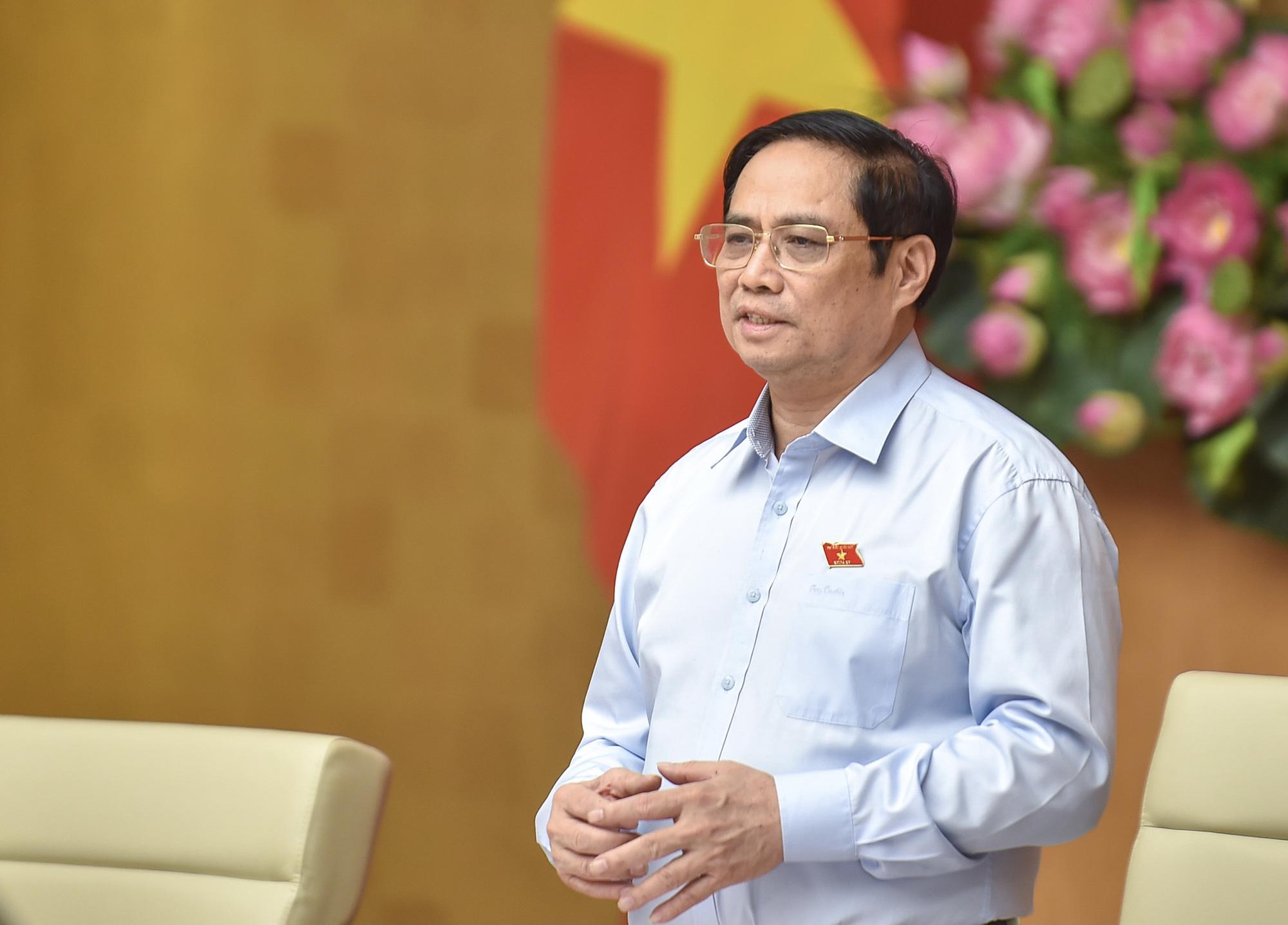 Thủ tướng: Giữ vững ổn định vĩ mô, đẩy mạnh giải ngân vốn đầu tư công từ nay đến cuối năm - Ảnh 1.