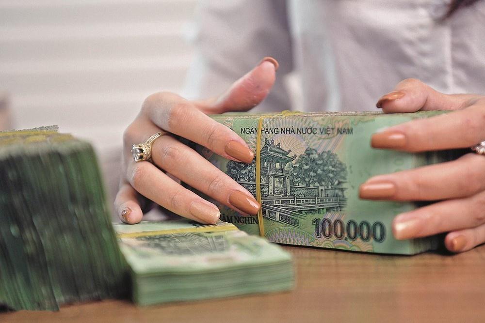 Mỗi tháng có khoảng 16.000 tỷ đồng nợ xấu được xử lý bởi các TCTD - Ảnh 1.