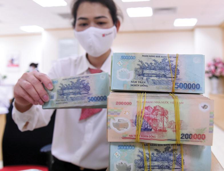 SSI Research: Một lượng tiền đồng sẽ được bơm ra ngoài thị trường trong tuần này - Ảnh 1.