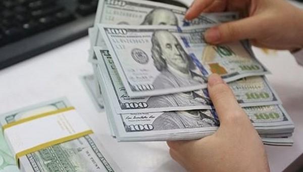 Tỷ giá USD chợ đen tăng mạnh, nguy cơ 'chảy' USD ra thị trường tự do? - Ảnh 1.