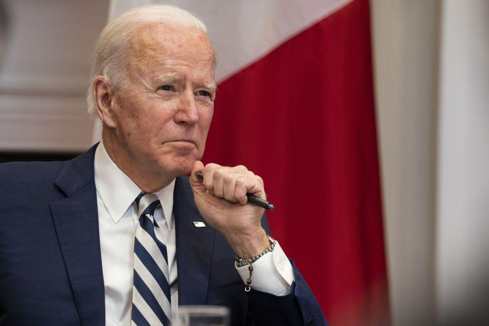 Ông Biden bị chê yếu đuối vì trừng phạt Nga và Arab Saudi nhẹ tay - Ảnh 1.