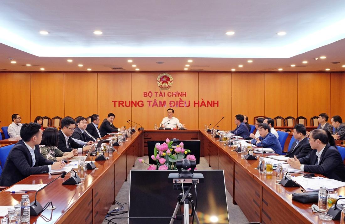 Bộ trưởng Đinh Tiến Dũng: Trước mắt không áp dụng đề xuất nâng lô lên 1.000, khuyến khích chuyển giao dịch từ HOSE sang HNX - Ảnh 1.