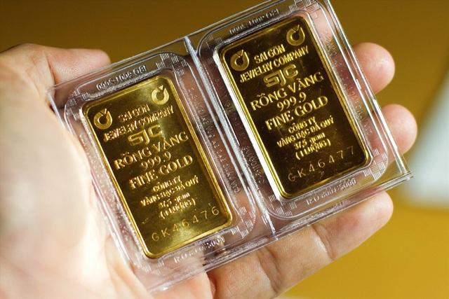 Đà tăng của giá vàng bị hạn chế do đồng USD mạnh lên - Ảnh 1.