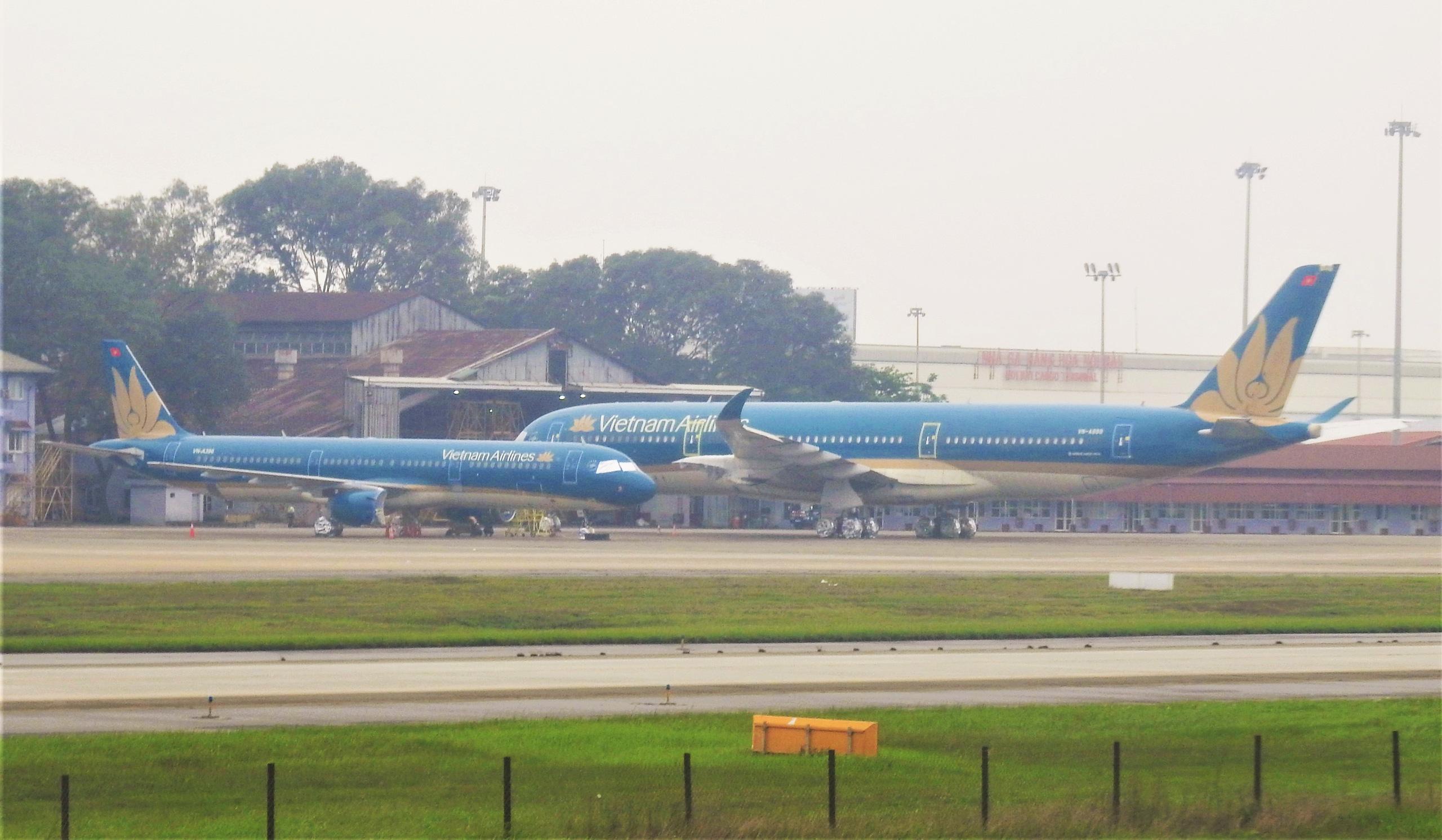 Cùng là doanh nghiệp Nhà nước về hàng không: Vietnam Airlines lo phá sản, ACV có hàng tỷ USD gửi ngân hàng - Ảnh 1.