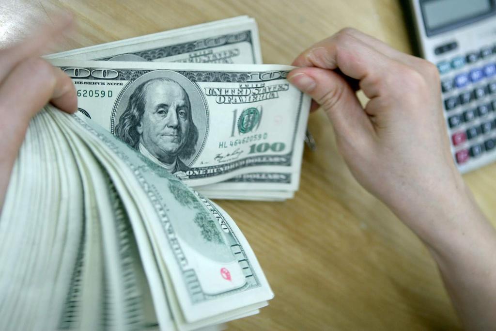 KBSV: NHNN giảm giá mua USD phần nào giải tỏa áp lực nhập khẩu lạm phát - Ảnh 1.