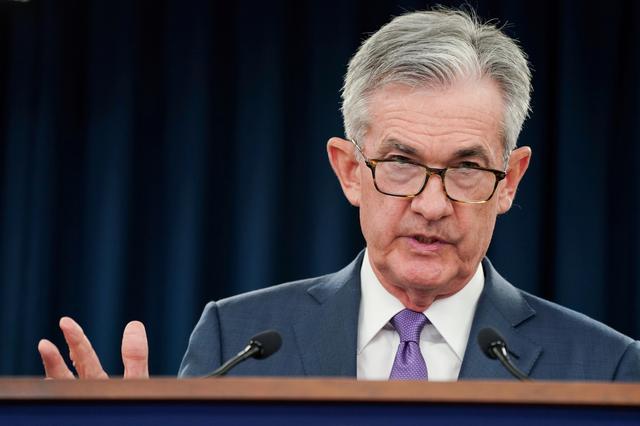 Fed dự báo sẽ duy trì chính sách lãi suất thấp  - Ảnh 1.