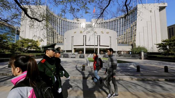 Ngân hàng trung ương Trung Quốc đang đi trước Fed một bước - Ảnh 1.
