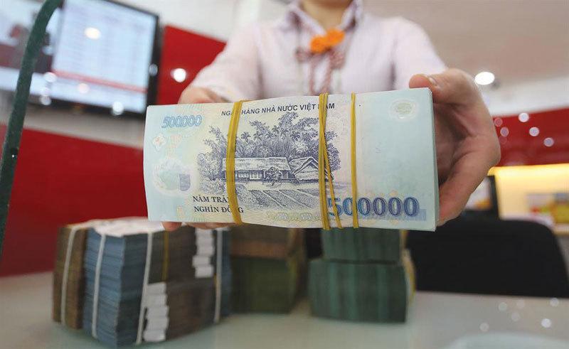 NHNN đồng ý cho các ngân hàng đủ tiêu chí 'nới room' tăng trưởng tín dụng - Ảnh 1.