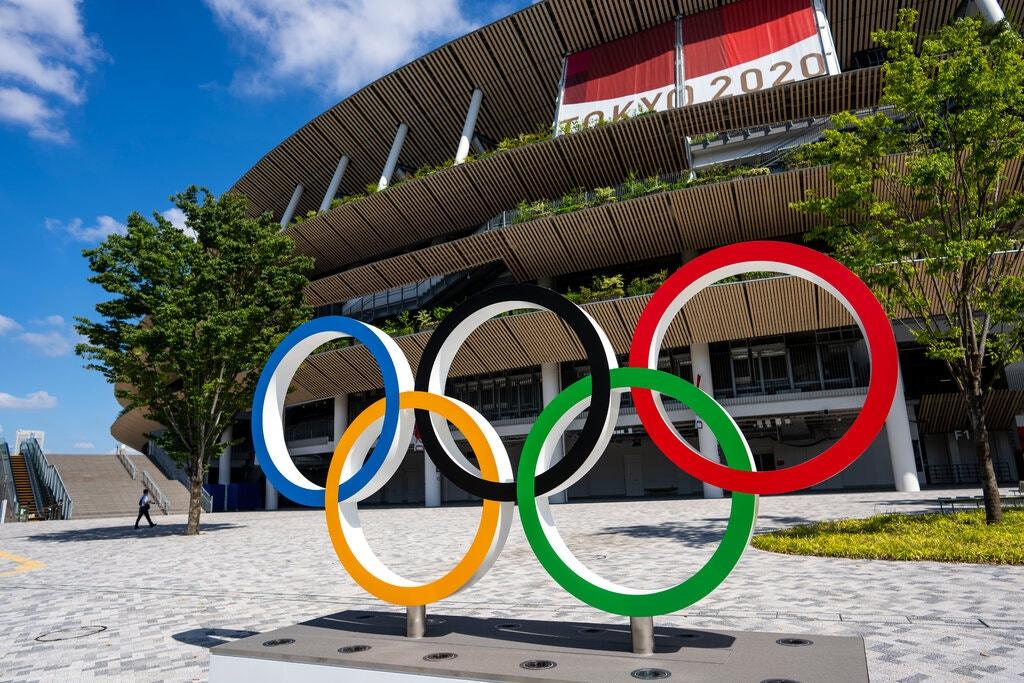 Dentsu: Bàn tay vô hình đằng sau Olympic Tokyo 2020 - Ảnh 1.