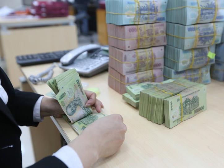 Tín dụng tăng nhanh trong nửa cuối tháng 6, các doanh nghiệp tiếp tục đẩy mạnh gửi tiền ngân hàng - Ảnh 1.