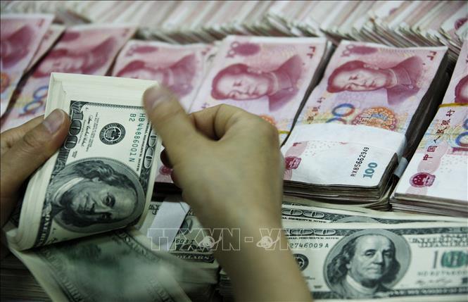Thỏa thuận tiền tệ Mỹ - Trung khôngthay đổi mối quan hệ giữa đồng USD và NDT - Ảnh 1.