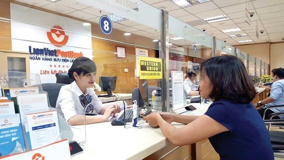 Thêm 2 ngân hàng hoàn tất việc tăng vốn điều lệ - Ảnh 1.