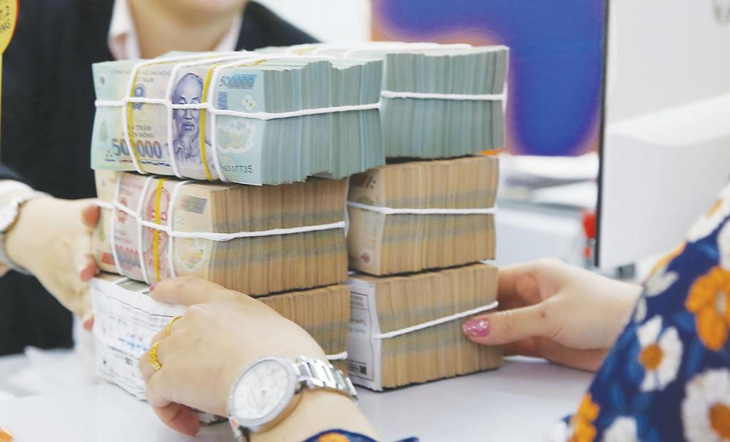 Loạt ngân hàng báo lãi 'khủng' trong 9 tháng đầu năm - Ảnh 1.