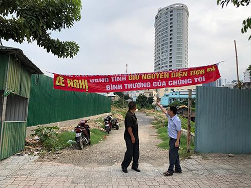 Dự án Khu dân cư cồn Tân Lập: Khách hàng rào đất, căng băng rôn kêu cứu - Ảnh 3.