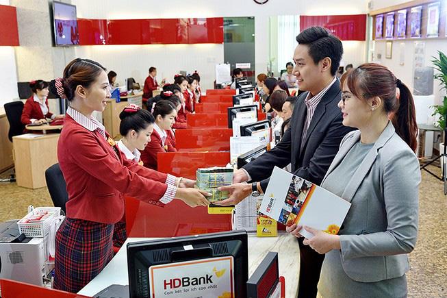 Nhìn lại kết quả kinh doanh của 18 ngân hàng Việt bị Moody's hạ triển vọng - Ảnh 2.