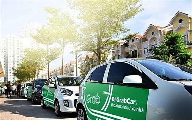 Doanh nghiệp Việt ngấm đòn từ taxi công nghệ - Ảnh 2.