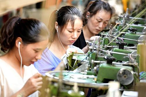 Kinh tế Trung Quốc được dự báo sắp cải thiện - Ảnh 1.