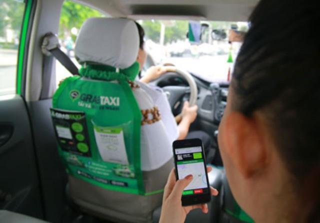 Bộ Tư pháp ủng hộ quan điểm của Grab, đề nghị xem xét khái niệm đơn vị kinh doanh vận tải bằng ô tô  - Ảnh 1.