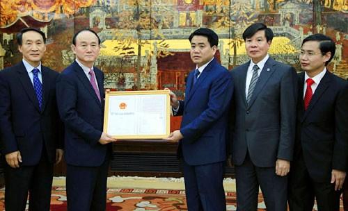 Thủ tướng ủng hộ Samsung sớm xây dựng trung tâm R&D 300 triệu USD tại Hà Nội - Ảnh 2.