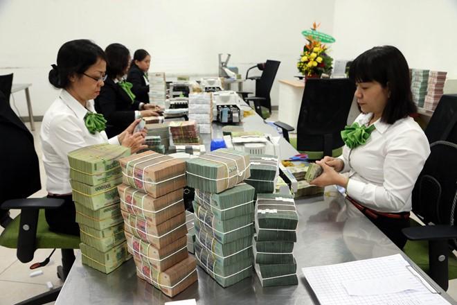 Vietcombank sẽ điều chỉnh lại lợi nhuận - Ảnh 1.