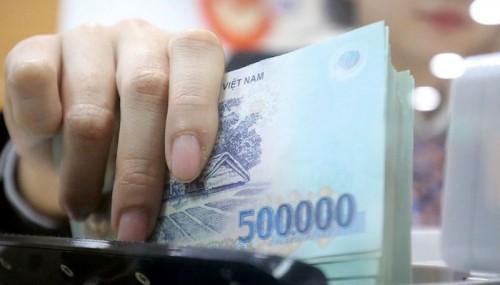 Nhiều nhà băng tiếp tục mua lại nợ xấu từ VAMC - Ảnh 1.