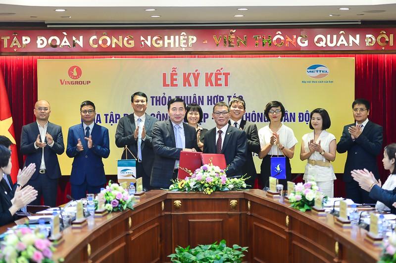 Vingroup thỏa thuận xây dựng điểm sạc, đổi pin xe điện tại các điểm kinh doanh của Viettel - Ảnh 1.