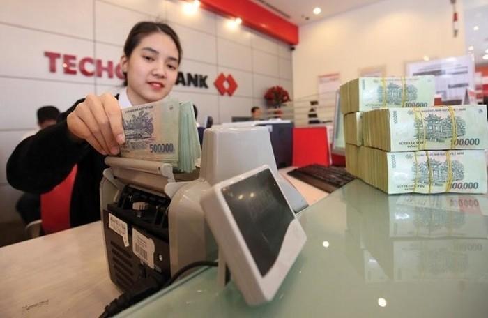 Hạn mức tăng trưởng tín dụng của các ngân hàng năm 2019 là bao nhiêu? - Ảnh 1.