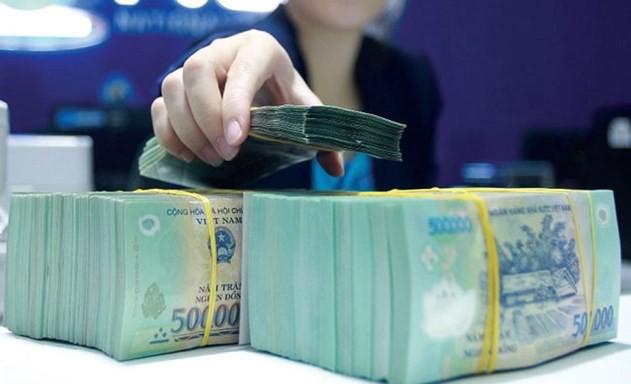 Vốn ngắn hạn cho vay trung dài hạn: Rủi ro cho cả ngân hàng và doanh nghiệp - Ảnh 1.