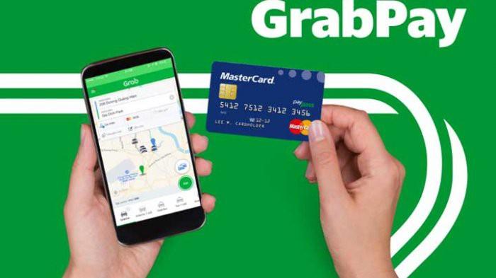 Reuters: Grab muốn thành lập ngân hàng - Ảnh 1.