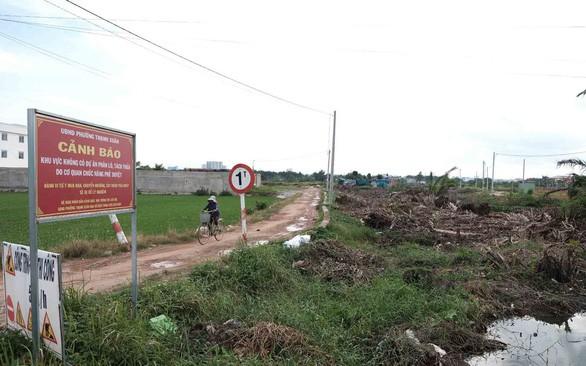 Bãi rác, nghĩa trang bị phân lô bán nền 'ma', tại sao cơ quan chức năng chỉ... cảnh báo? - Ảnh 1.