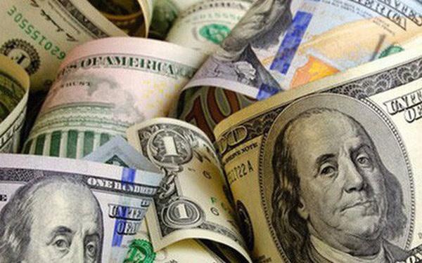 Đồng USD chạm đỉnh 2 năm sau quyết định giảm lãi suất của Fed - Ảnh 1.