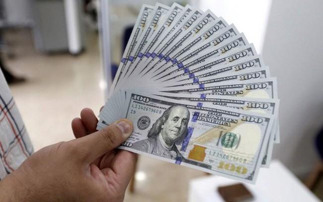 USD trong nước tăng giá sau quyết định của Fed - Ảnh 1.