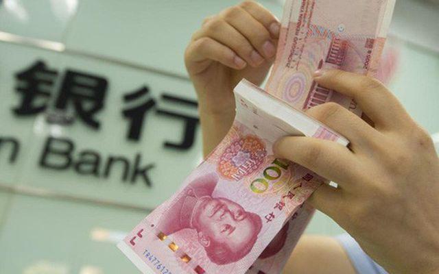 Trung Quốc tiếp tục giảm tỷ giá nhân dân tệ  - Ảnh 1.