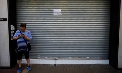 Kinh tế Hong Kong ảm đạm vì biểu tình - Ảnh 1.